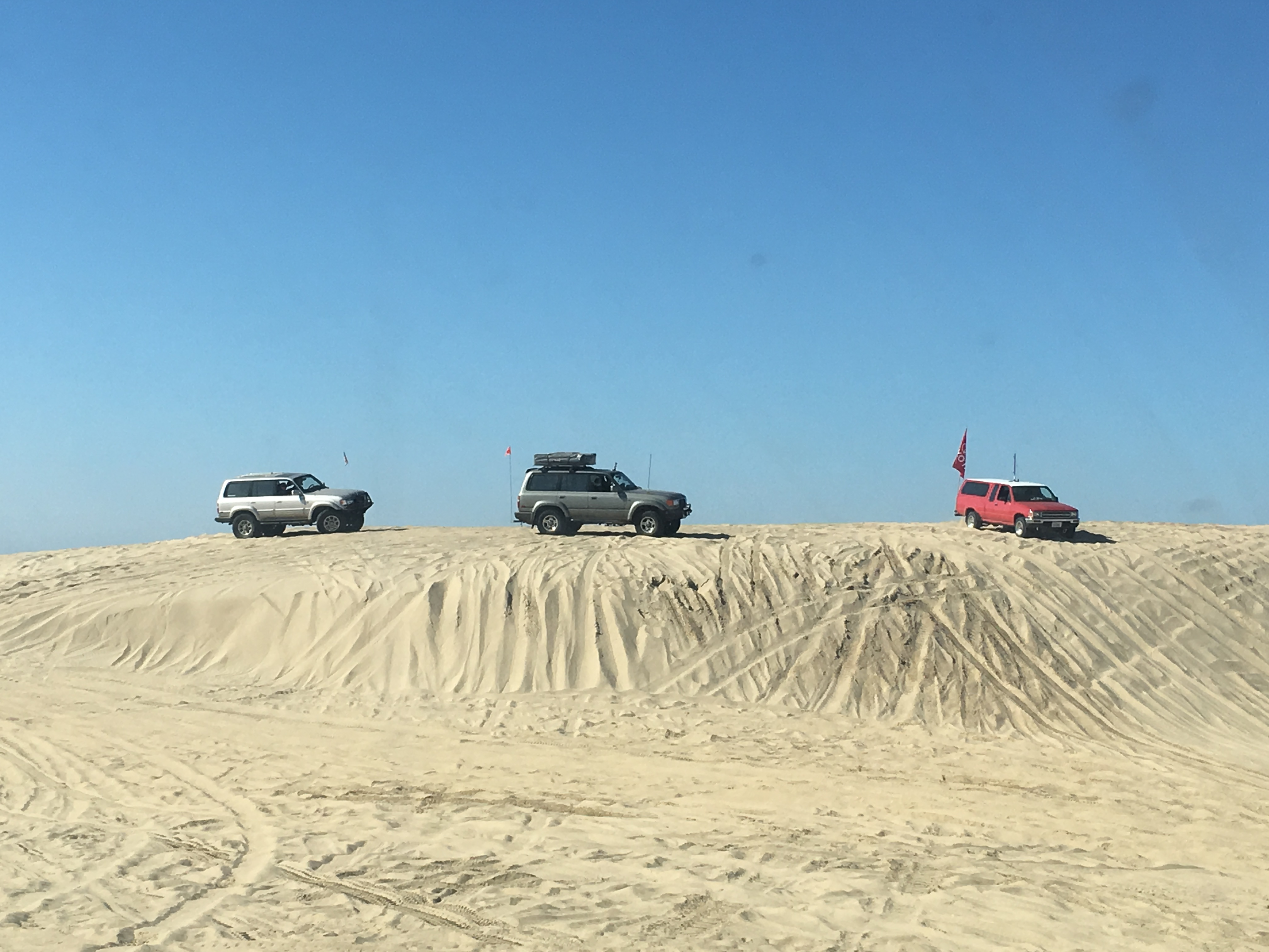 Two Toyota Land Cruisers & A Pickup